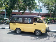 This type of shared minivan is known by many names: bemo, angkot, mikrolet, lyn, oplet, and others. Bemos are shared vans that typically run on a set route, but drivers can easily be hired to go to a specific destination for the right price. There is a set price for riding the bemo regardless of your destination which can range from 2,000 to 5,000 IDR.