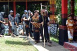 The guest greeters lead the guest to tongkonan at Rambu Solok Ceremony at Palawa, Sadan, 2014-Dec
