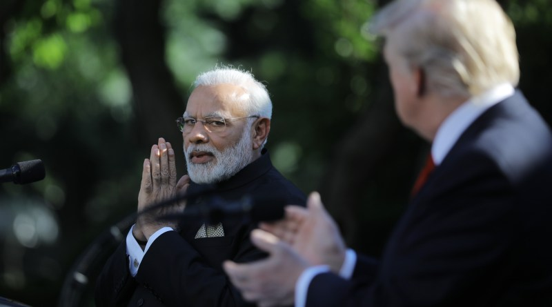 U.S. President Trump applauds Indian Prime Minister Modi during joint news conference in the Rose Garden of the White House in Washington