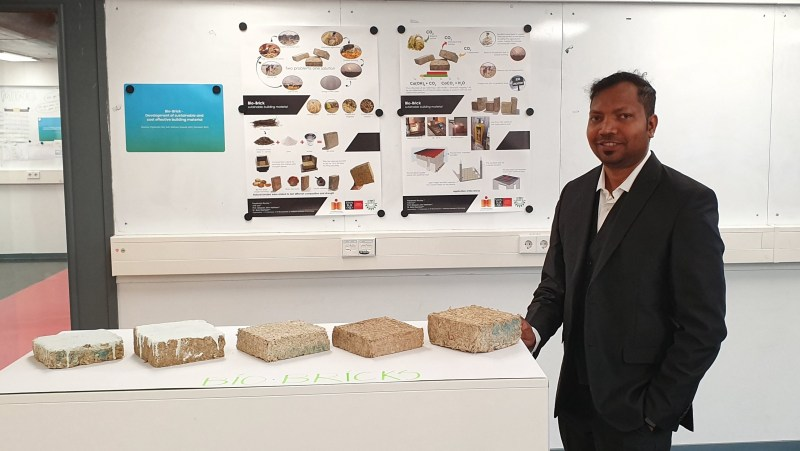 Priyabrata Rautray with the Bio Bricks at International Conference on Engineering Design ICED 2019 at TU Delft Netherlands | Indus Dictum