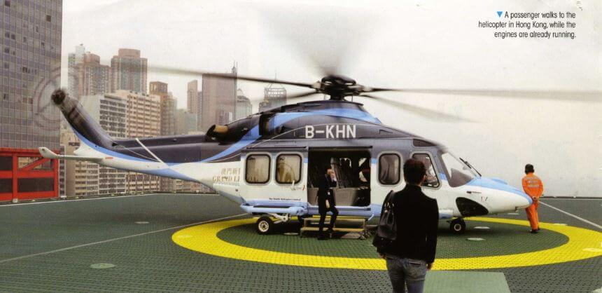 Pearl River Heliports Image 7 PASSENGER WAlks To The Helicopter In Hong Kong While The Enginese Already Running IDJ