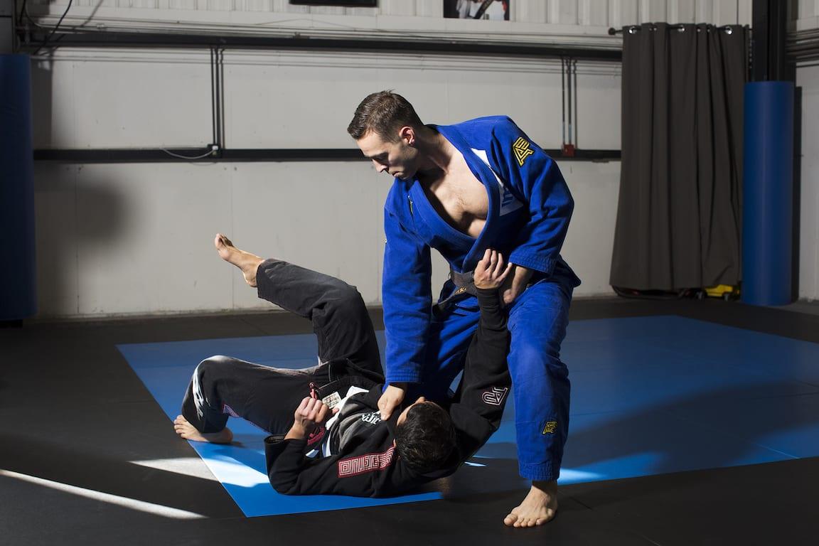 An Industrial Strength coach demonstrating the effectiveness of a Brazilian Jiu Jitsu throw and grapple.