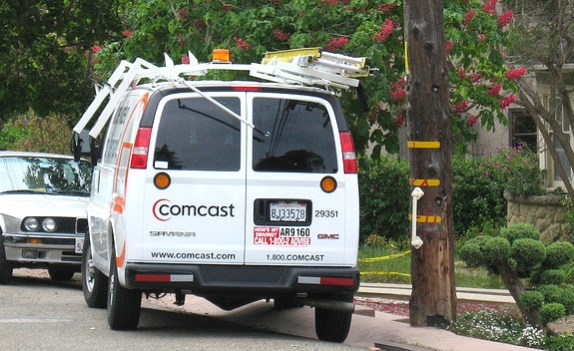 Comcast van parked in a residential neighborhood answering a consumer call for service