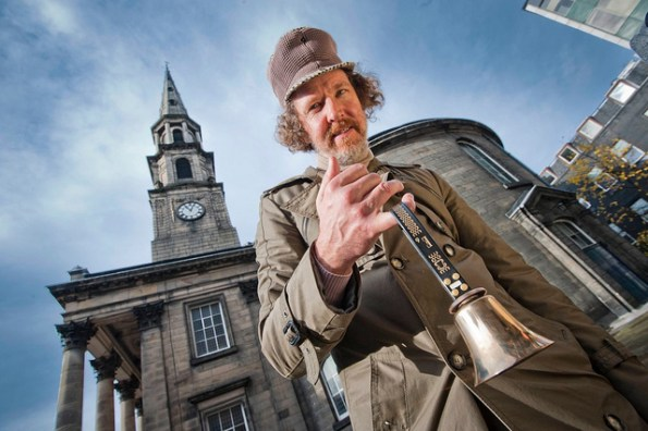 Artist Martin Creed poses holding a bell to promote Work No. 1197: All the bells.