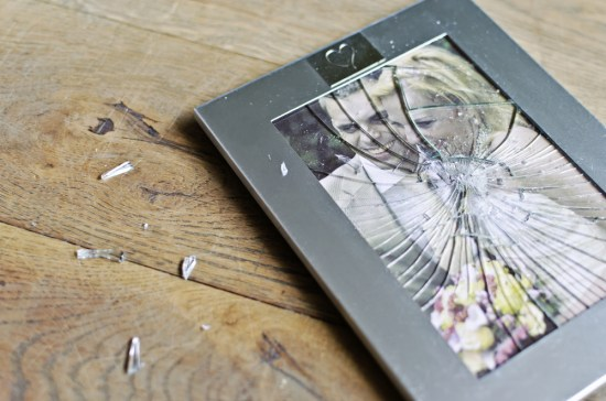 A shattered wedding photo of a couple.