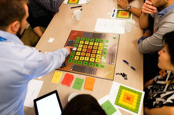 Indie game developers using crowdfunding by Kickstarter have a play test session during the game design process.