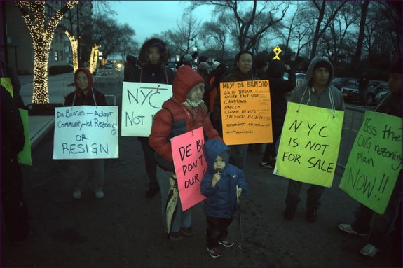 Community activists participate in a rally for affordable housing in New York City at Gracie Mansion—Mayor Bill De Blasio's rent-free home.