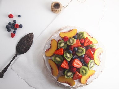 A fruit pavlova and a spoon.