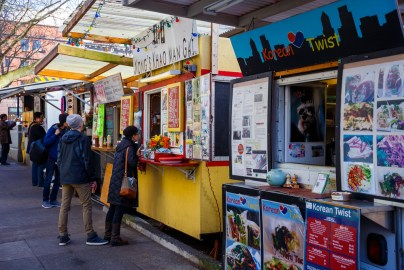 A row of customers at some food trucks in Portland.