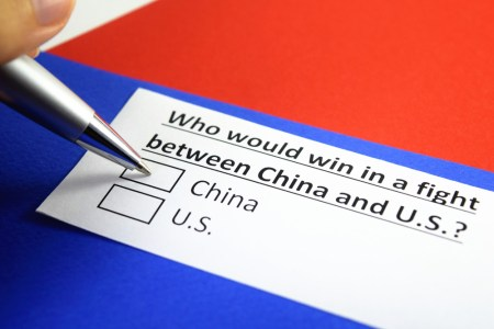 "A piece of paper that reads, ""Who would win in a fight between China and the U.S?"""