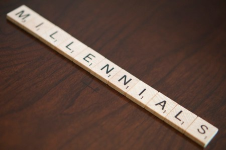 "Scrabble letters that spell out ""millennials."""