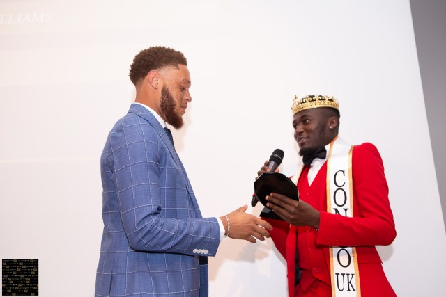 male model Shaquille Williams being presented his award by mr congo 2018/19 Jeffrey Samba
