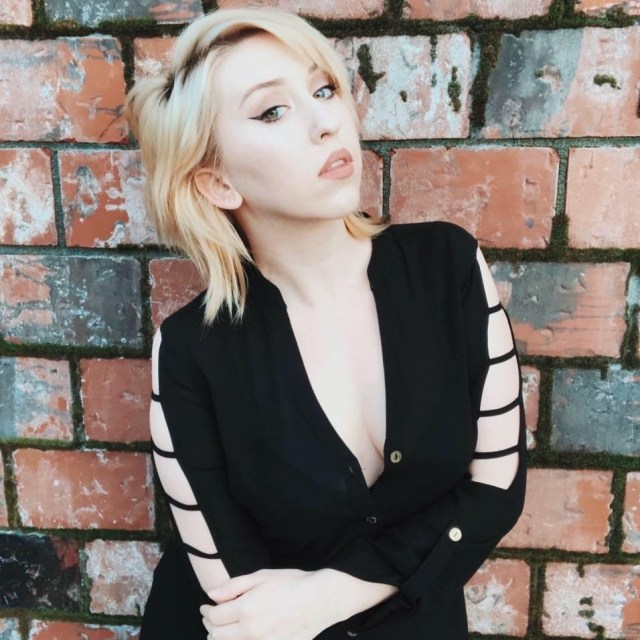 Kathana looking sassy in a black blouse