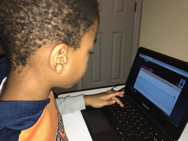 JB completing an online reading assessment.