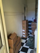 Mostly empty storage area in the utility room.