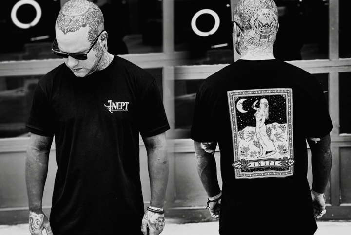 Side by side picture of the owner showing the front and back of the tarot tshirt
