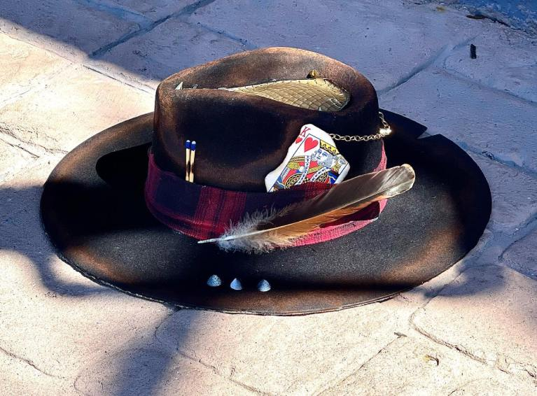 Black custom hat with red plaid decor, studs and chains, and a king of hearts