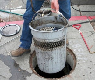This curb inlet basket is one of the types of inlets used to filter stormwater directly at the drain. Photo: City of San Diego Storm Drain Inlet Pilot Study report.