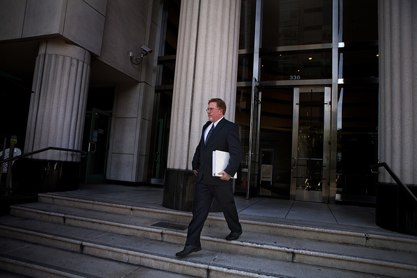 Attorney Cory Briggs leaves court after arguing a case against the city of San Diego. Photo by Sam Hodgson.