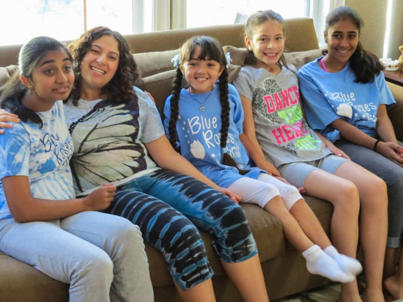 Members of Blue Roses Girls with autism spectrum disorders get together at the co-founder's home before practicing for an upcoming dance recital.