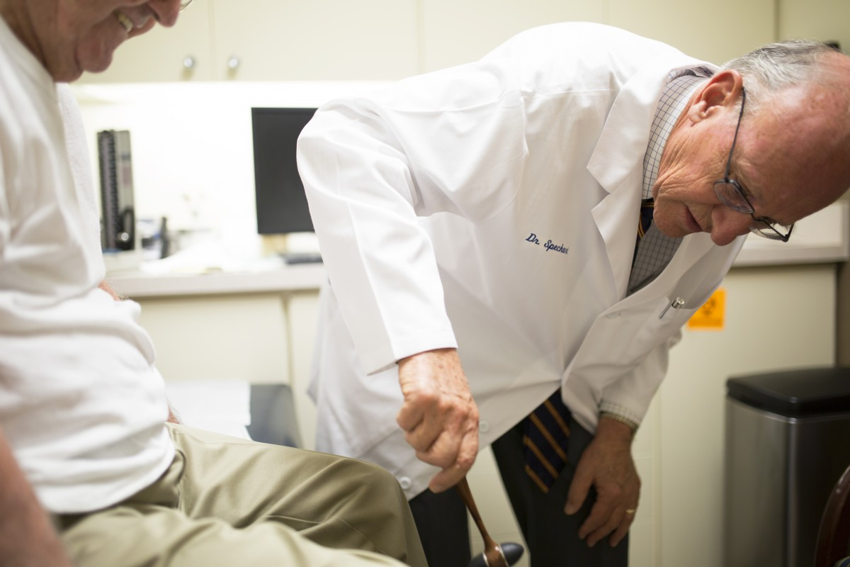 Dr. Paul Speckart, a San Diego internist, conducts a physical evaluation of one of his patients in August 2015.