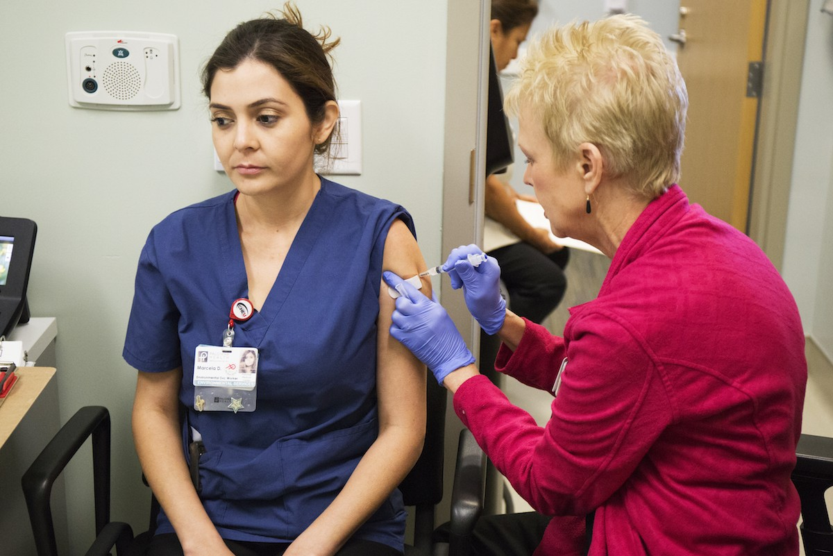 ​​Marcela Delatone, an environmental services worker at Palomar Health, ​​​​​​gets the influenza vaccination at Palomar Health, Sept. 21, 2015. Megan Wood, inewsource