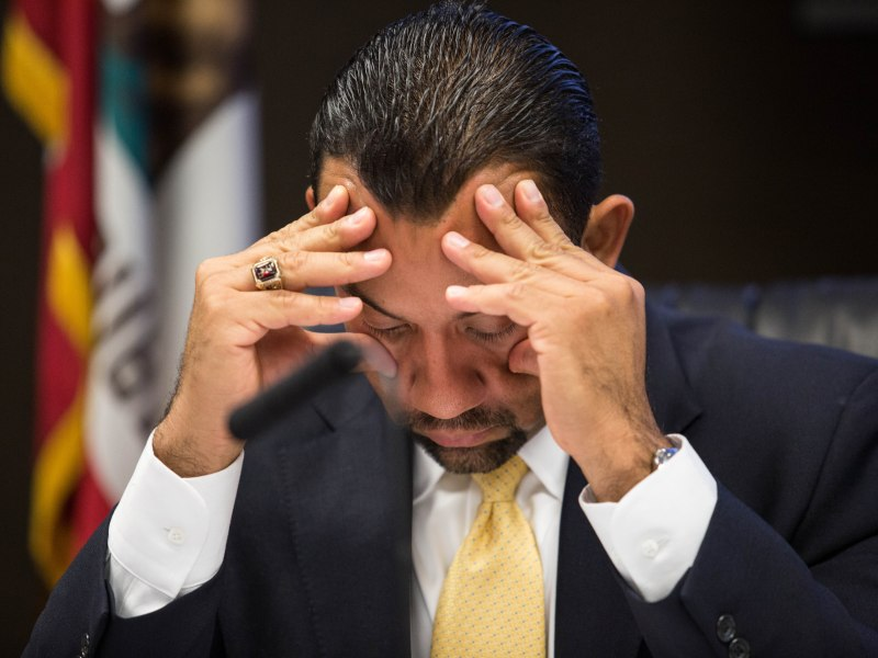 San Ysidro School District Superintendent Julio Fonseca sits with his head in his hands during a district board meeting in this undated photo. Megan Wood, inewsource