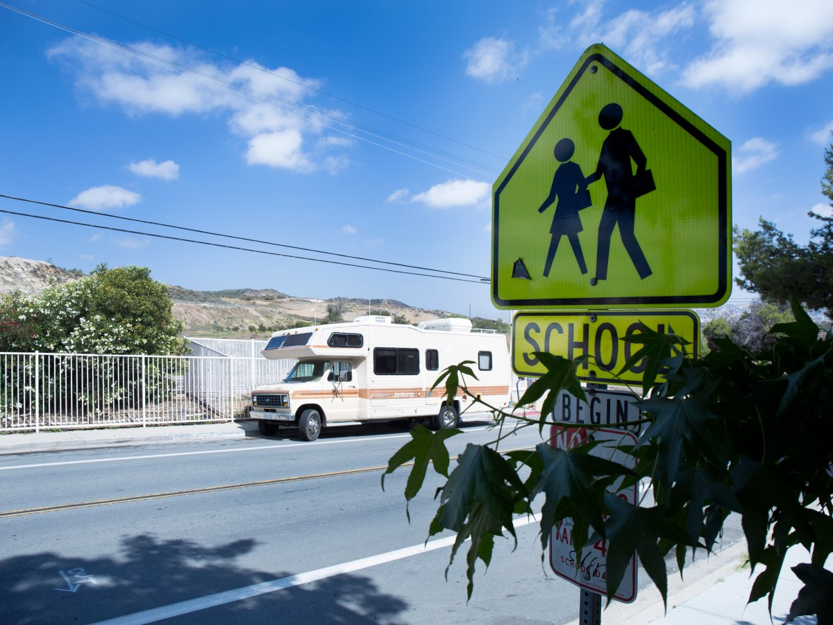 The empty lot where Beyer Elementary used to be is visible behind an old school crossing sign. May 26, 2016. Megan Wood, inewsource.