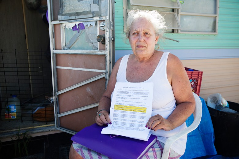 Nita Brown, a resident of the RV park since August 2015, holds the eviction notice she received on June 10 2016. Megan Wood, inewsource.