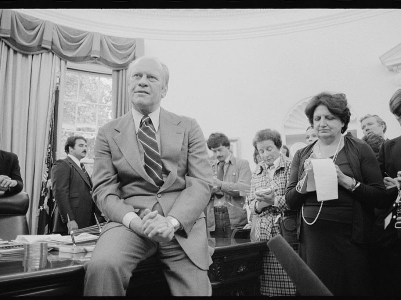 President Gerald Ford talks with reporters, including Helen Thomas, as White House Chief of Staff Richard Cheney looks on, during a press conference at the White House, Washington, D.C. Courtesy of the Library of Congress