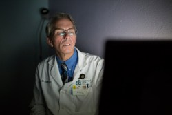 Dr. Jim Schultz of Neighborhood Healthcare in Escondido reviews results of a patient's retina exam. Dec. 16, 2016. Megan Wood, inewsource.