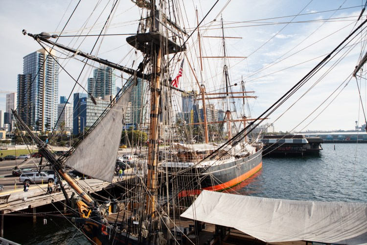 Two Maritime Museum vessels, the HMS Surprise in front and the Star of India behind it, sit in the San Diego harbor. Feb. 16, 2017. Leonardo Castaneda, inewsource.