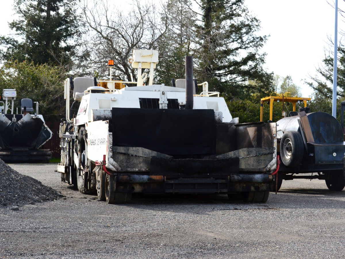 A highway paving machine in the yard of Skip Brown, whose Delta Construction company is a plaintiff in a lawsuit challenging a California diesel exhaust rule. March 9, 2017. Ingrid Lobet, inewsource