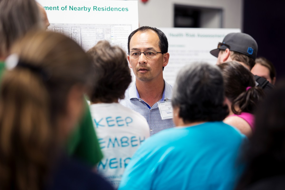 Truong Mai, a partner at Ametek environmental consultant ERM, staffs the air testing table at a community meeting on the underground contamination in El Cajon. June 4, 2017. Megan Wood/inewsource