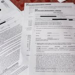 A refugee family shared its rental documents for an apartment at Sunset Gardens in El Cajon. Identifying information has been redacted. (Megan Wood/inewsource)