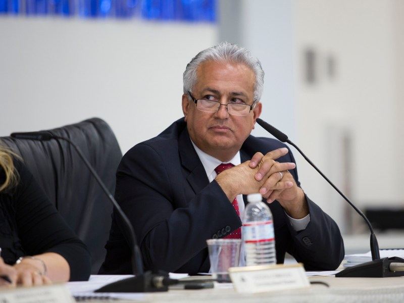Edward Velasquez listens during a 2015 San Ysidro School District board meeting, where he served as interim superintendent. (Megan Wood/inewsource)