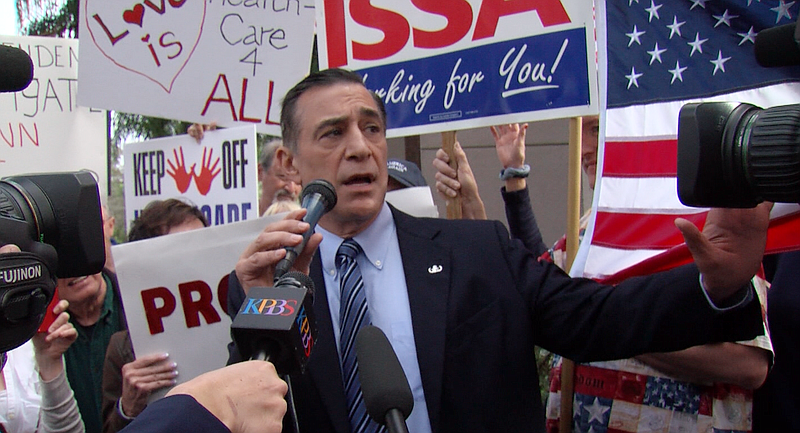 Rep. Darrell Issa (R-Vista) talks to a crowd of 200 supporters and critics outside of his North County office on Feb. 21, 2017. (Video screen grab by Matthew Bowler/KPBS)