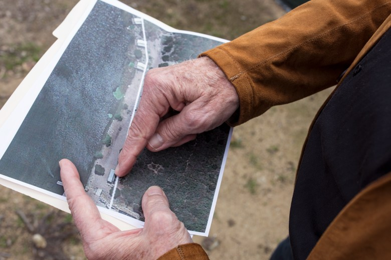 Varadero resident Kip McBane points to satellite imagery of the property line between Citizens Development and Varadero. At least one structure crosses that line. (Megan Wood/inewsource)