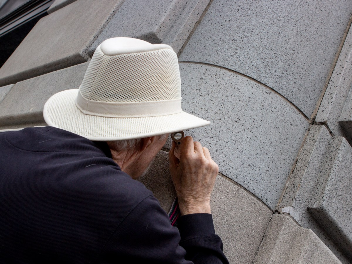 Geologist and SDSU Professor Emeritus Pat Abbott inspects the facade of the historic Spreckel's building on Broadway in downtown San Diego on May 23, 2018.
