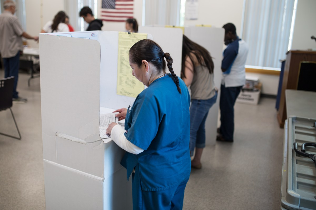 Voters are shown casting ballots at the City Heights/Weingart Library on June 5, 2018. (Megan Wood/inewsource)