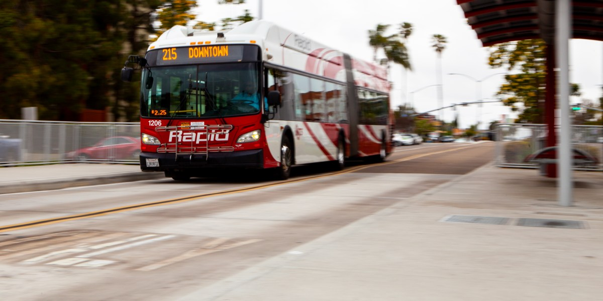 The Mid-City Rapid 215 bus approaches a stop on University Avenue in San Diego while traveling down a dedicated lane on Park Boulevard on April 16, 2019. (Brandon Quester/inewsource)