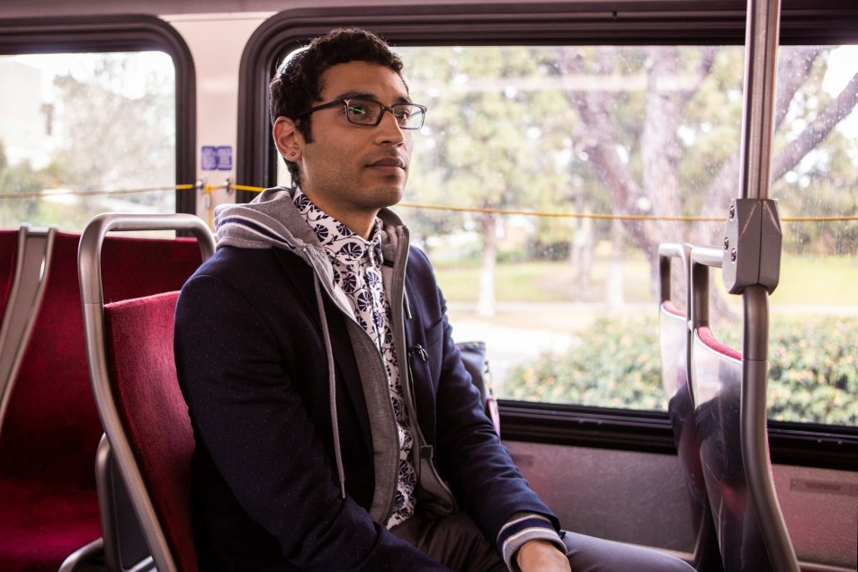 Mass transit advocate Matthew Vasilakis, on his way home from his job in University Heights, rides the Mid-City Rapid 215 bus on March 4, 2019. (Megan Wood/inewsource)