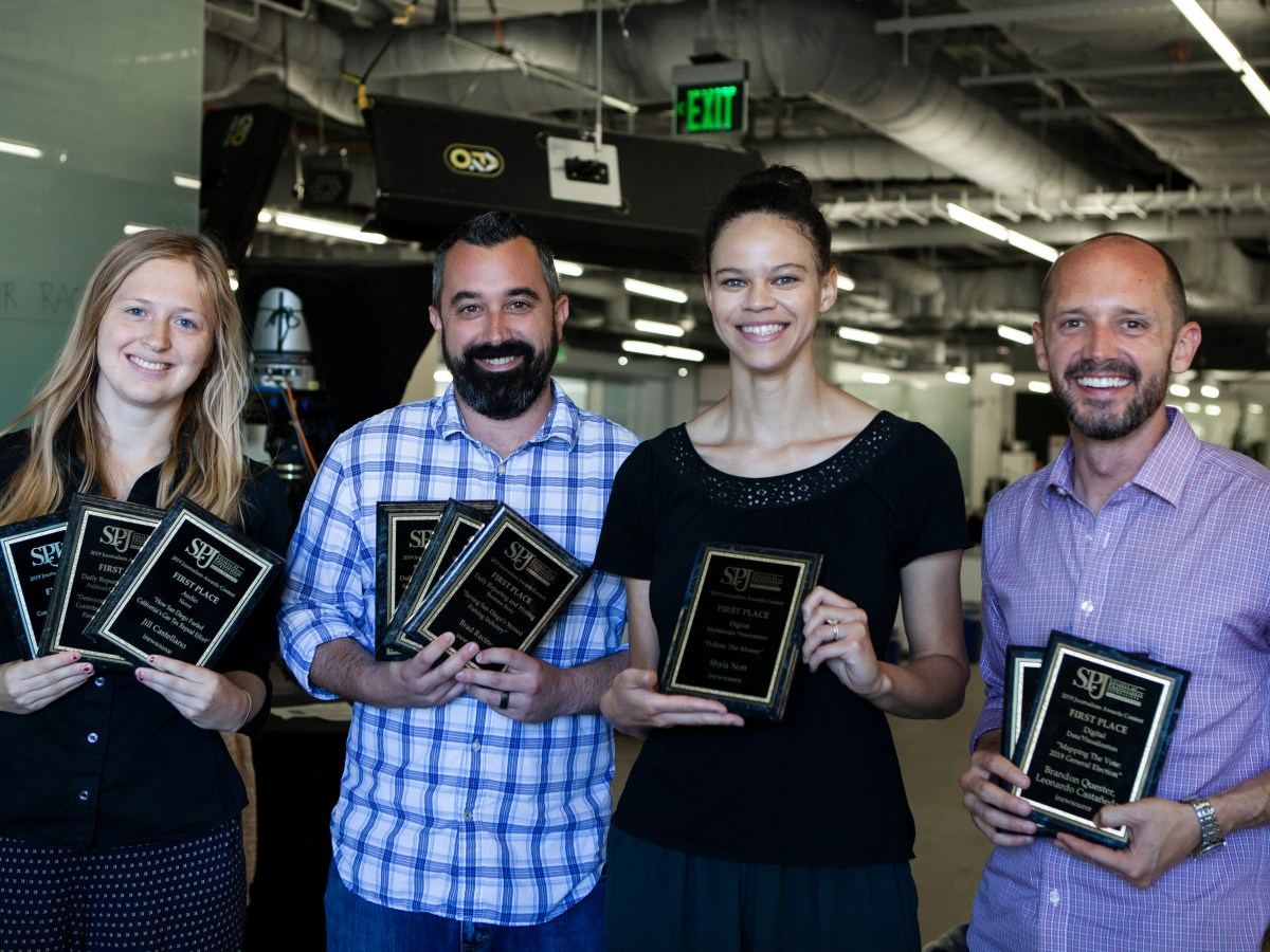 inewsource staff members Jill Castellano, Brad Racino, Shyla Nott and Brandon Quester holding their awards from the San Diego chapter of the Society of Professional Journalists.