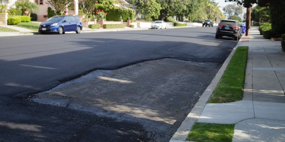 A San Diego street repaved — big hole not included