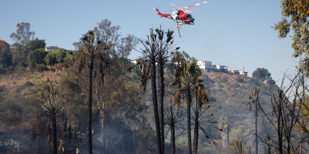 San Diego fire department crews put down a fire near Fairmont Avenue and Aldine Drive in San Diego, Oct. 15, 2019.