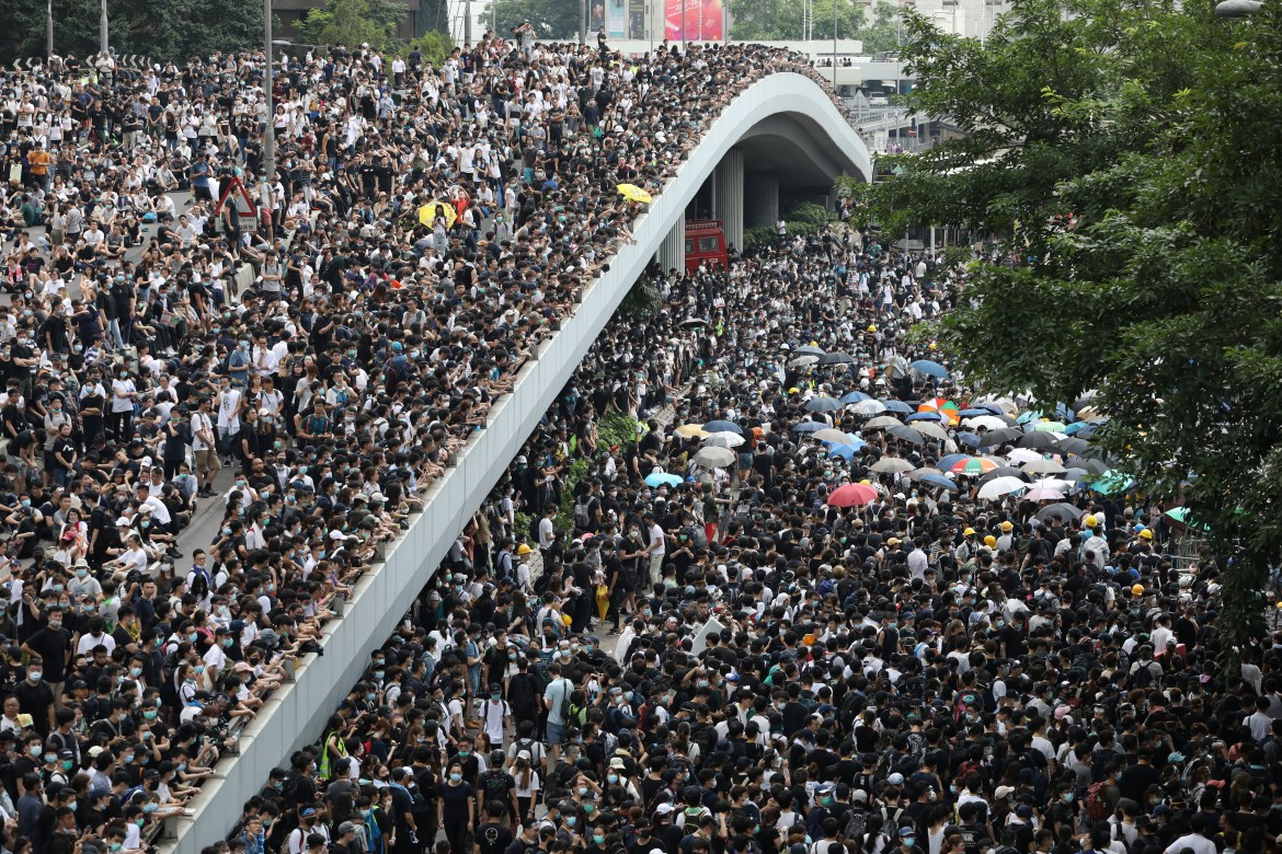 Protesters march along a road demonstrating against a proposed extradition bill in Hong Kong, China, June 12, 2019.