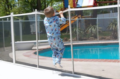 child-over-pool-fence