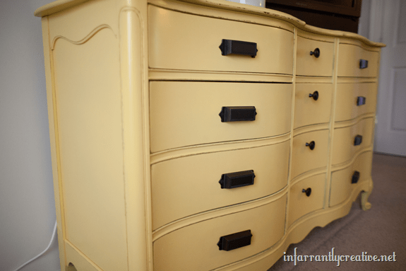 distressed yellow painted dresser