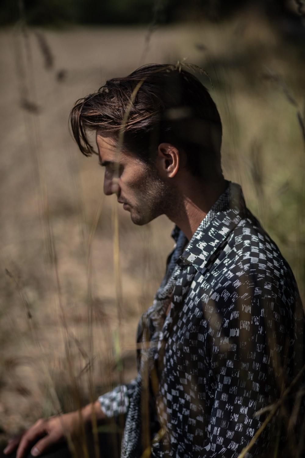 male model romantic fashion editorial field tree saint laurent silk shirt field