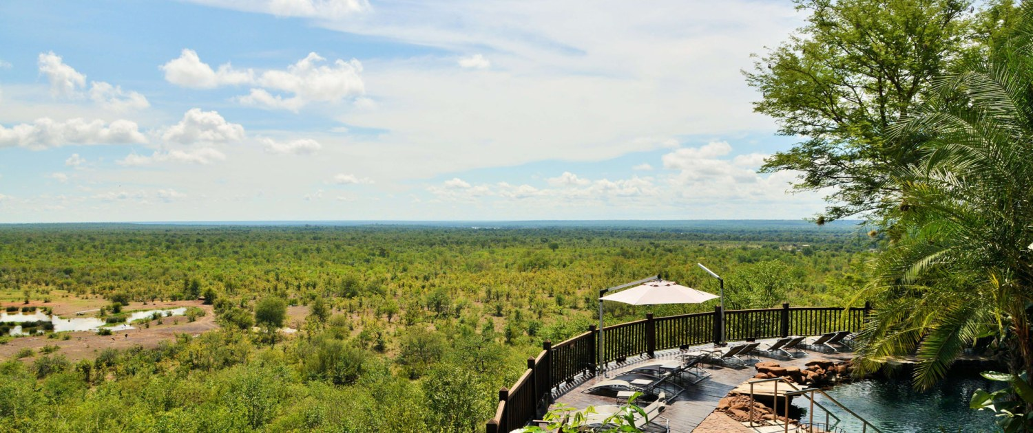 infinite_africa_travel_zimbabwe_victoria_falls_safari_lodge_pool_and_waterhole_views